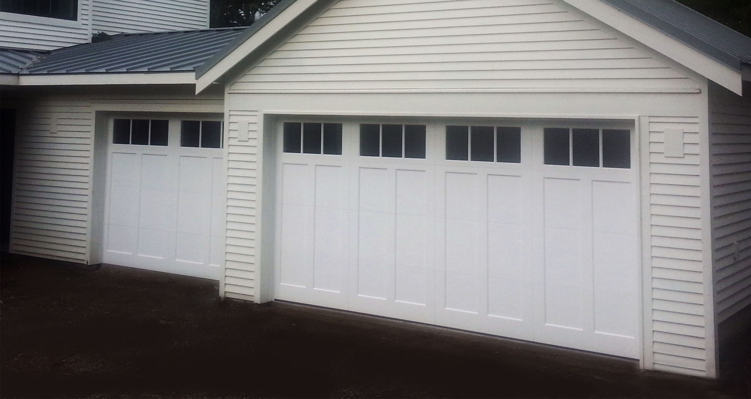 siding door on mn manufacturers a with white gray doors black chi semi installation transparent minnesota two filter wood elite garage house carriage in